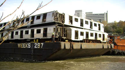 Barge transporting subways on the east river
